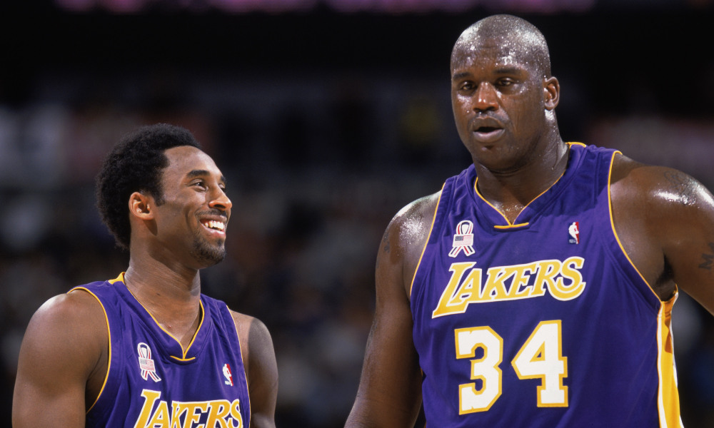 Kobe Bryant talks with Shaquille O''Neal.